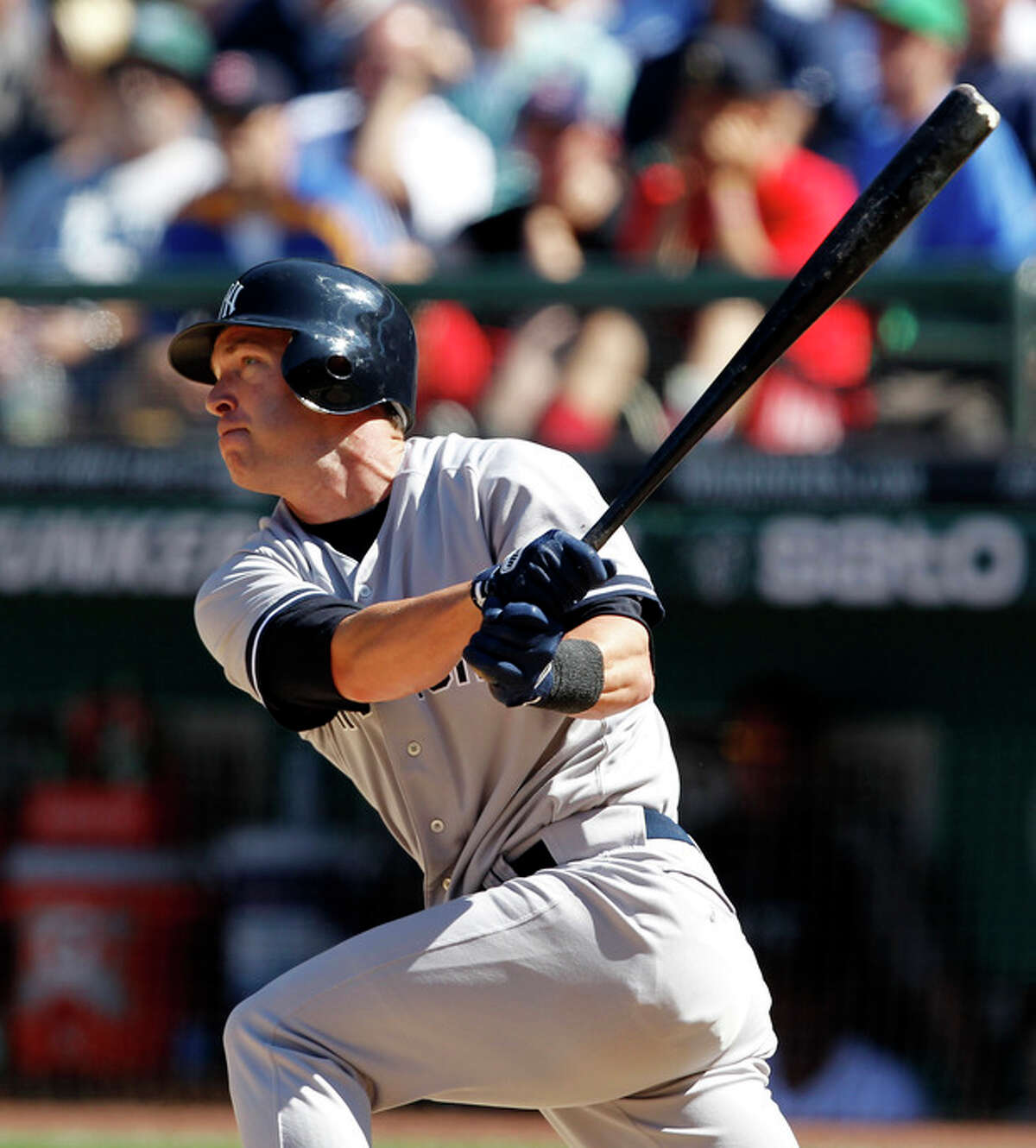 New York Yankees pinch hitter Jayson Nix watches the path of his three-run double against the Seattle Mariners in the eighth inning of a baseball game on Wednesday, July 25, 2012, in Seattle. (AP Photo/Elaine Thompson)
