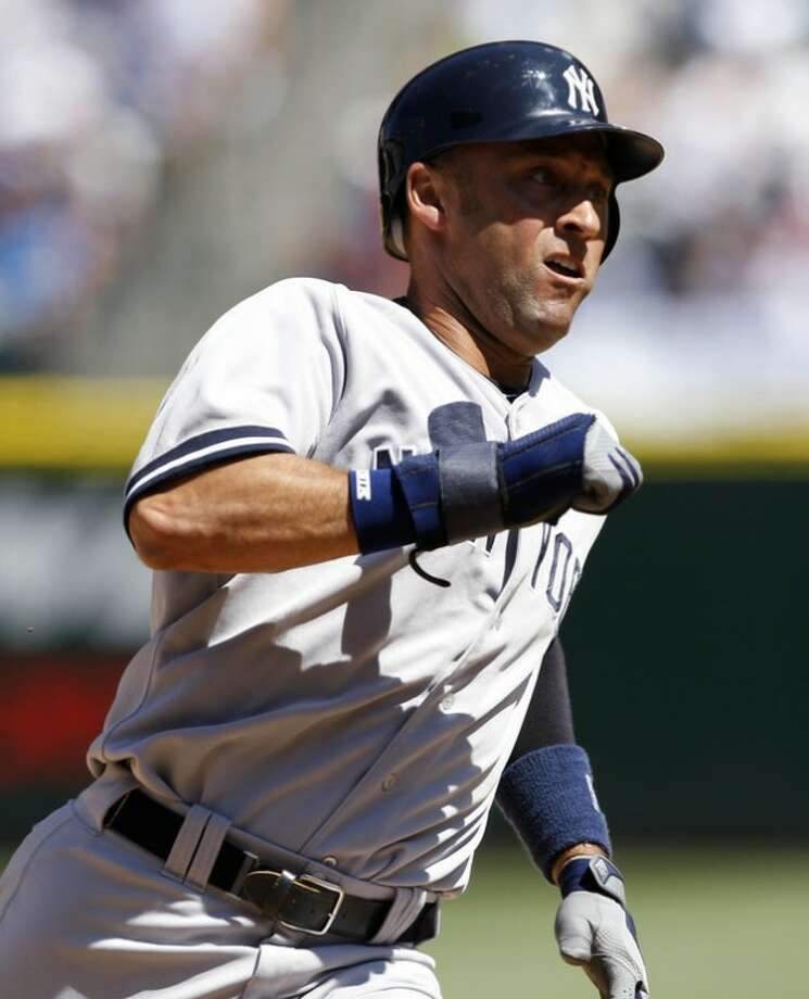 New York Yankees' Derek Jeter races to third in the fifth inning against the Seattle Mariners in a baseball game on Wednesday, July 25, 2012, in Seattle. (AP Photo/Elaine Thompson)