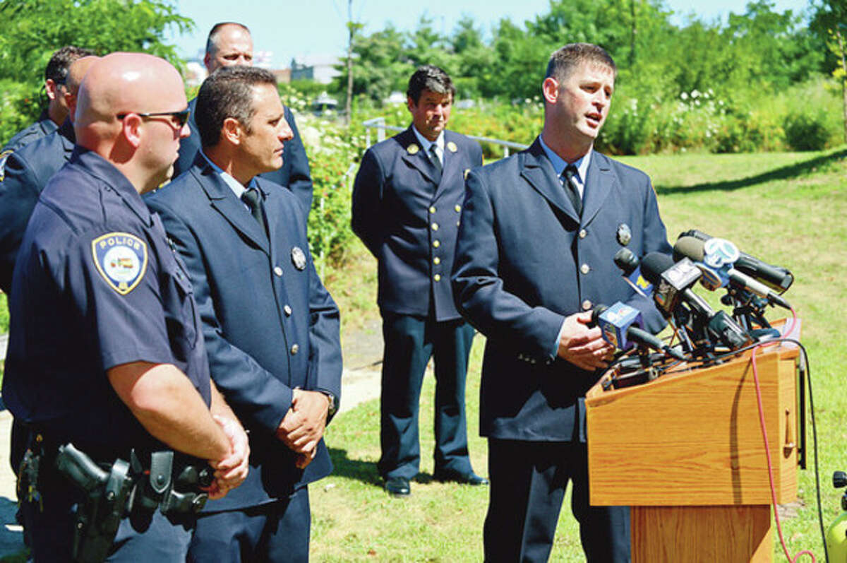 """File Photo by Erik Trautmann. From left, rescue divers Dan Ehret, Joe Maida and Bill O""""Connell, who helped save the remaining passengers on a boat that capsized in Stamford Harbor in late July. The boat's operator was killed in the accident."""