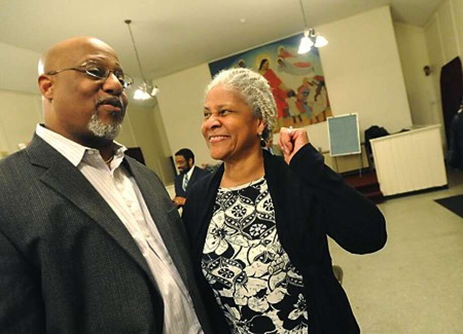 Outgoing President Lindsay Curtis and incoming President Anita B. Schmidt at the Norwalk Chapter of the NAACP''s branch elections Tuesday night at the Calvary Baptist Church in Norwalk. hour photo/matthew vinci