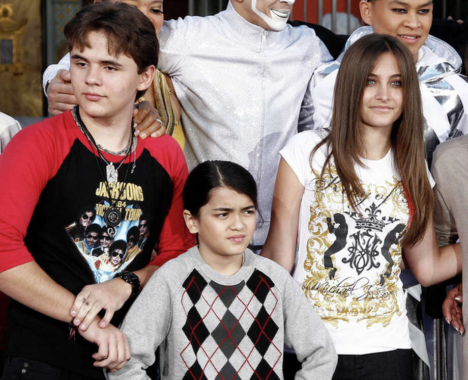 "FILE - This Jan. 26, 2012 file photo shows, from left, Prince Jackson, Blanket Jackson and Paris Jackson after a hand and footprint ceremony honoring their father musician Michael Jackson in front of Grauman's Chinese Theatre in Los Angeles. The executors of Michael Jackson's estate say they are concerned about the welfare of the singer's mother and his three children. In a letter posted on fan sites Tuesday, July 24, executors John Branca and John McClain says they are doing what they can to protect them from ""undue influences, bullying, greed, and other unfortunate circumstances."" The letter came hours after sheriff's deputies responded for a family disturbance at the hilltop home where Katherine Jackson and her three grandchildren live. No arrests were made, but there is an active battery investigation. Katherine Jackson was reported missing over the weekend, but is with relatives in Arizona. (AP Photo/Matt Sayles) / AP"