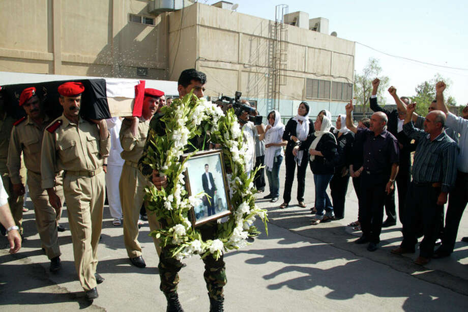 FILE- In this file photo released by the Syrian official news agency SANA on July 15, 2011, Syrian soldiers carry the coffin of a killed comrade who was reportedly killed in recent violence in the country, outside a hospital in the western province of Tartous, Syria. In the recent sectarian violence in Syria, some observers see a grim pattern: Alawite fighters from President Bashar Assad's minority sect trying to carve out a breakaway region for themselves by driving out local Sunnis, killing entire families and threatening anybody who stays behind. If the regime falls, the Alawite heartland on Syria's mountainous coast could become a refuge for the community and even Assad himself to fight for survival against the Sunni majority. (AP Photo/SANA, File) EDITORIAL USE ONLY / SANA