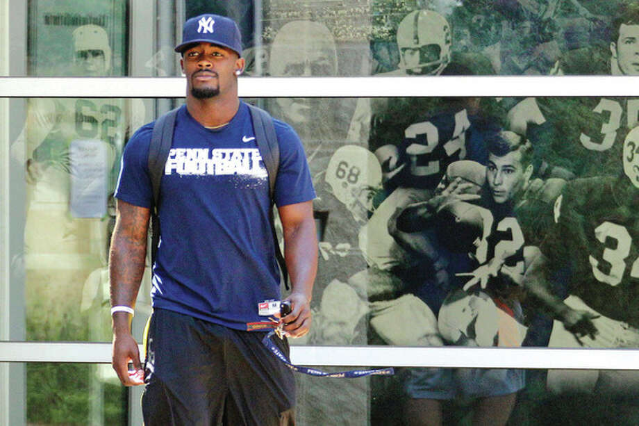 AP photoPenn State running back and Norwalk resident Silas Redd leaves the Lasch Football building after Monday's team meetings explaining the ramifications of the NCAA sanctions against the Nittany Lions' football program in the wake of the Jerry Sandusky abuse case and the investigation into the school's handling of the matter. / AP