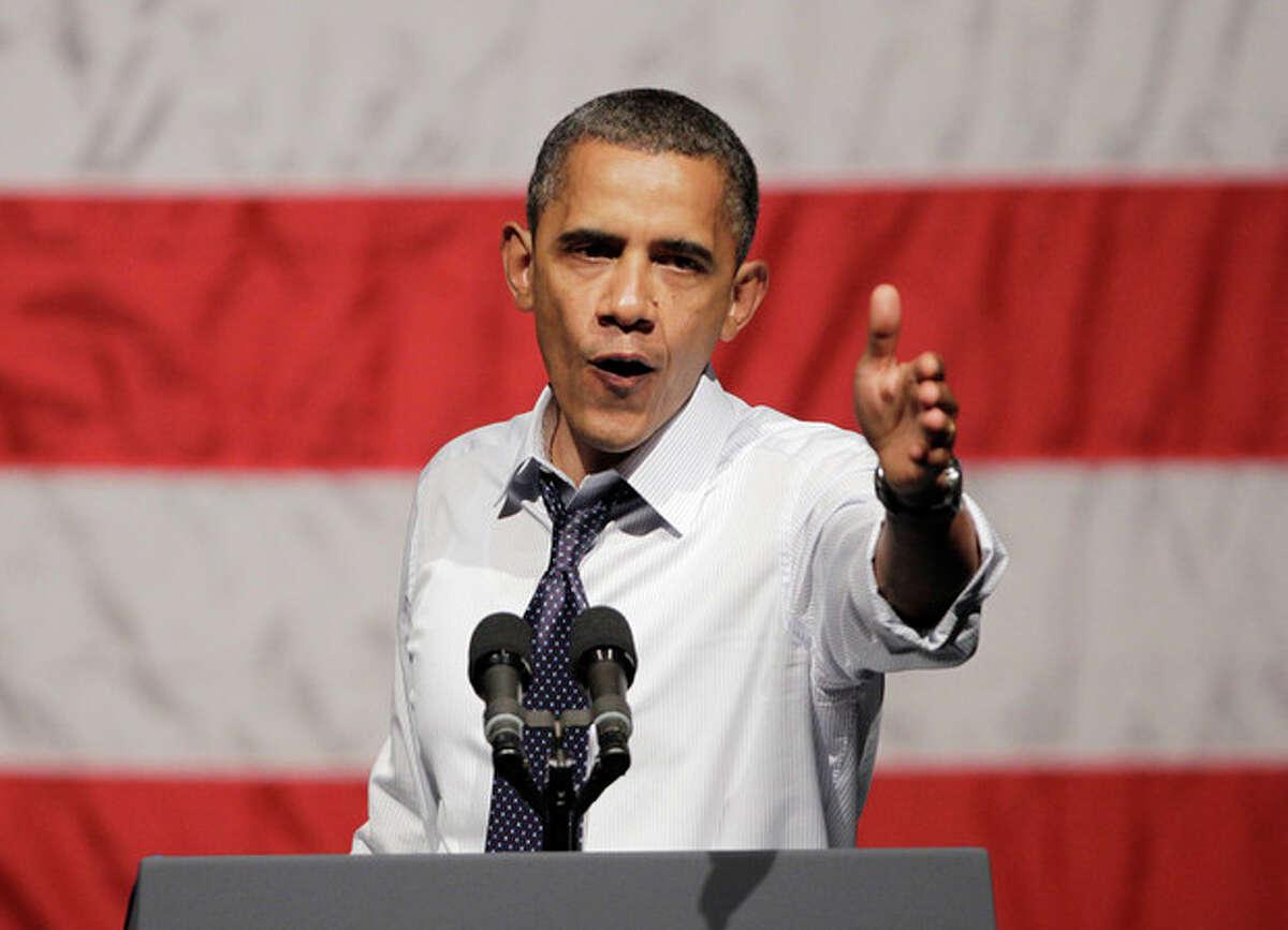 President Barack Obama gestures at a campaign stop in Oakland, Calif., Monday, July 23, 2012. (AP Photo/Paul Sakuma)