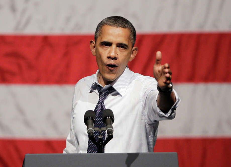 President Barack Obama gestures at a campaign stop in Oakland, Calif., Monday, July 23, 2012. (AP Photo/Paul Sakuma) / AP
