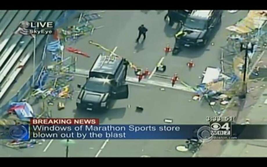 A screen capture from CBS shortly after an explosion at the Boston Marathon.