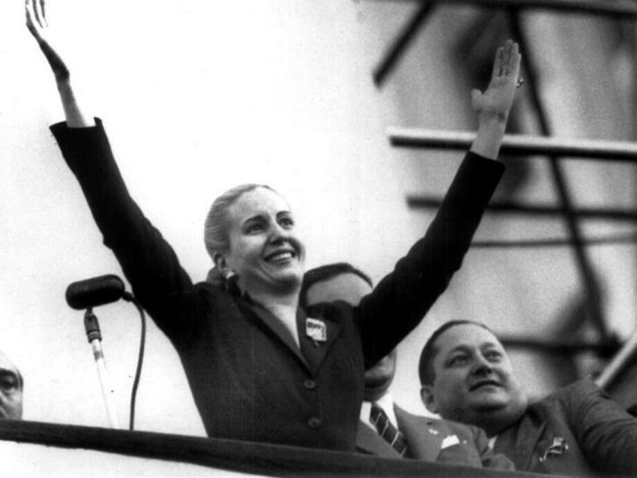 FILE - In this Oct. 17, 1951 file photo, Maria Eva Duarte de Peron waves to supporters in Buenos Aires, Argentina. Argentina commemorates the 60th anniversary of the death of Argentina's most famous first lady on Thursday, July 26, 2012. Evita died of cancer on July 26, 1952 at the age of 33. (AP Photo/Archivo Clarin, File) / CLARIN