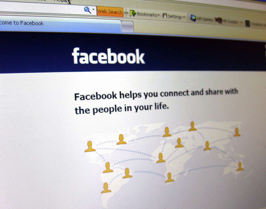 This June 20, 2012 photo shows a Facebook login page on a computer screen in Oakland, N.J. Facebook is expected to report their quarterly financial results after the market closes on Thursday, July 26, 2012. (AP Photo/Stace Maude) / AP