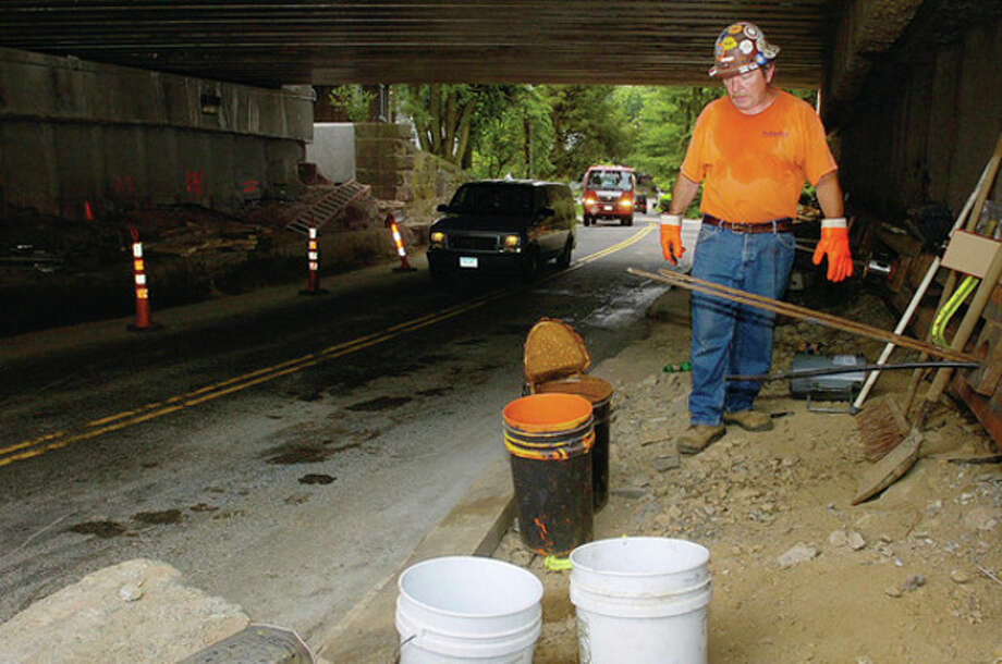 Greg Mix of Schnabel Foundation works on the Metro North bridge over Rowayton Ave. The Common CouncilÕs Public Works Committee advances a resolution on Rowayton Avenue roadwork after adding fail-safe language. / (C)2011, The Hour Newspapers, all rights reserved