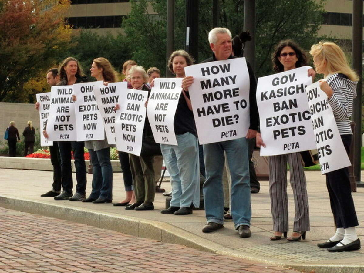 Supporters of People for the Ethical Treatment of Animals gather outside the Ohio Statehouse to push for a ban on exotic animal ownership on Wednesday, Oct. 26, 2011, in Columbus, Ohio. The gathering was spurred by the shooting by authorities of 48 animals released by a farm owner last week before he committed suicide. (AP Photo/Kantele Franko)