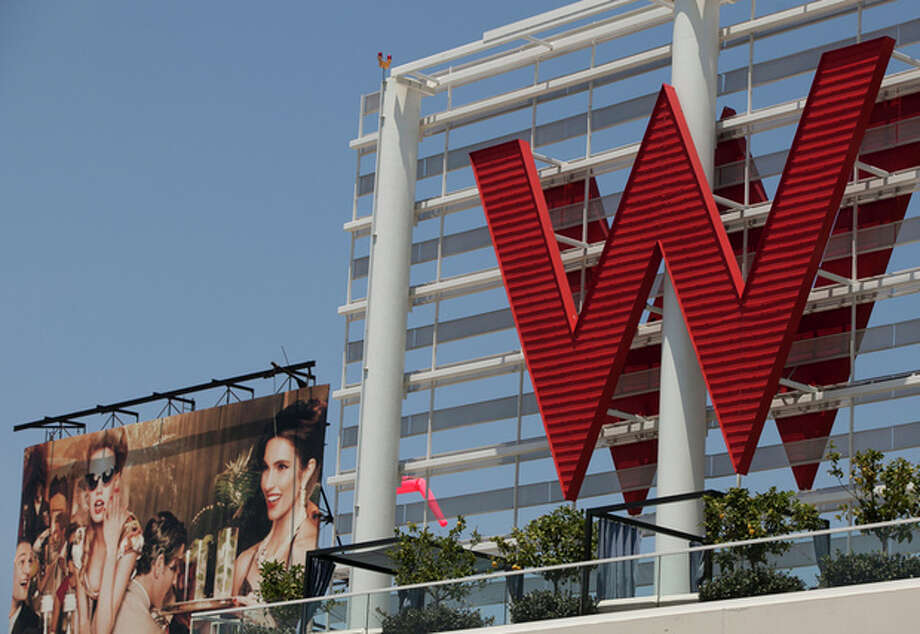 A Tuesday, July 17, 2012 photo, shows Starwood Hotels W Hollywood hotel logo in Los Angeles. Starwood Hotels & Resorts Worldwide Inc. said Thursday July 26, 2012, its second-quarter net income declined 7 percent as it dealt with costs tied to early debt extinguishment. (AP Photo/Damian Dovarganes) / AP