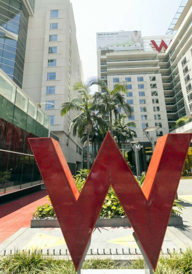 This Tuesday, July 17, 2012 photo, shows theStarwood Hotels W Hollywood hotel logo in Los Angeles. Starwood Hotels & Resorts Worldwide Inc. said Thurssday July 26, 2012, its second-quarter net income declined 7 percent as it dealt with costs tied to early debt extinguishment. (AP Photo/Damian Dovarganes)