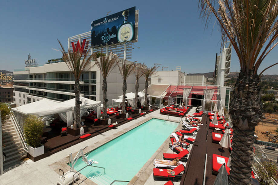 A Tuesday, July 17, 2012, photo, shows Starwood Hotels W Hollywood hotel rooftop pool in Los Angeles. Starwood Hotels & Resorts Worldwide Inc. said Thursday July 26, 2012, its second-quarter net income declined 7 percent as it dealt with costs tied to early debt extinguishment. (AP Photo/Damian Dovarganes) / AP