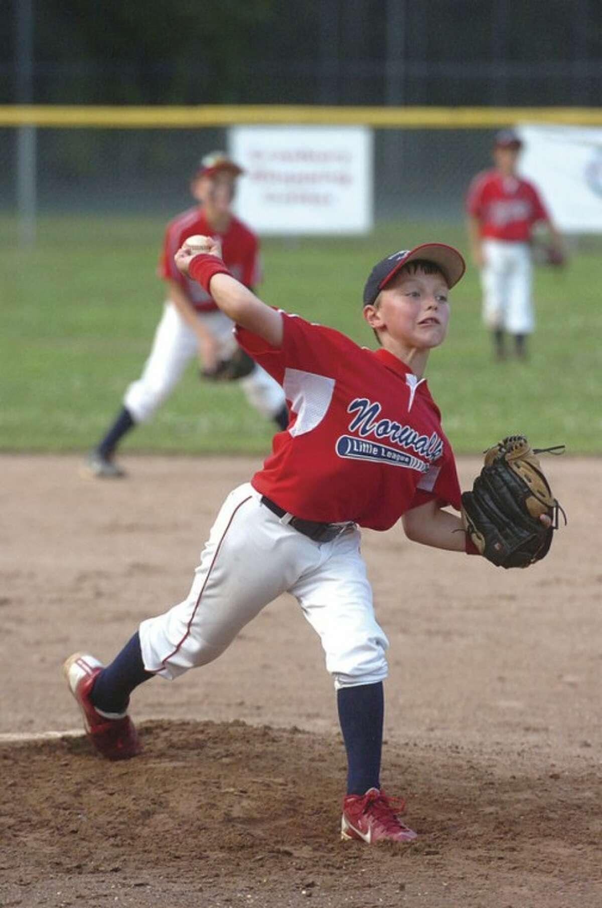 Hour Photos/ Alex von Kleydorff Above, Norwalk Little League pitcher Sean Buzzee fires to the plate.