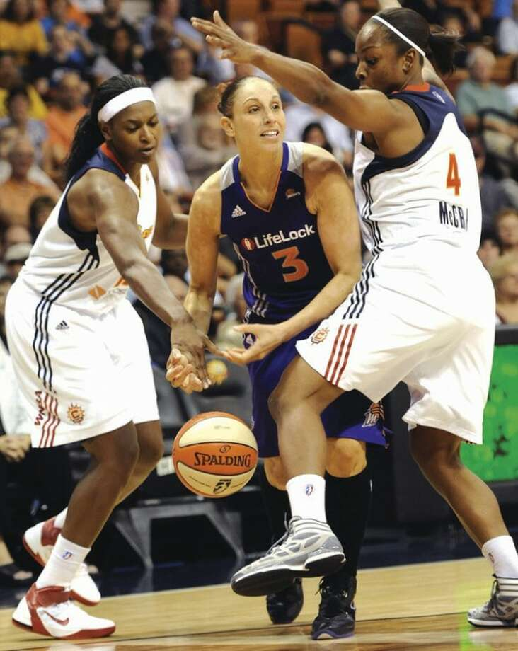 AP photo Asjha Jones of the Connecticut Sun, left, knocks the ball away from Phoenix Mercury's Diana Taurasi, center, as Connecticut's Danielle McCray, right, defends during Friday night's game. The Sun won, 95-92.