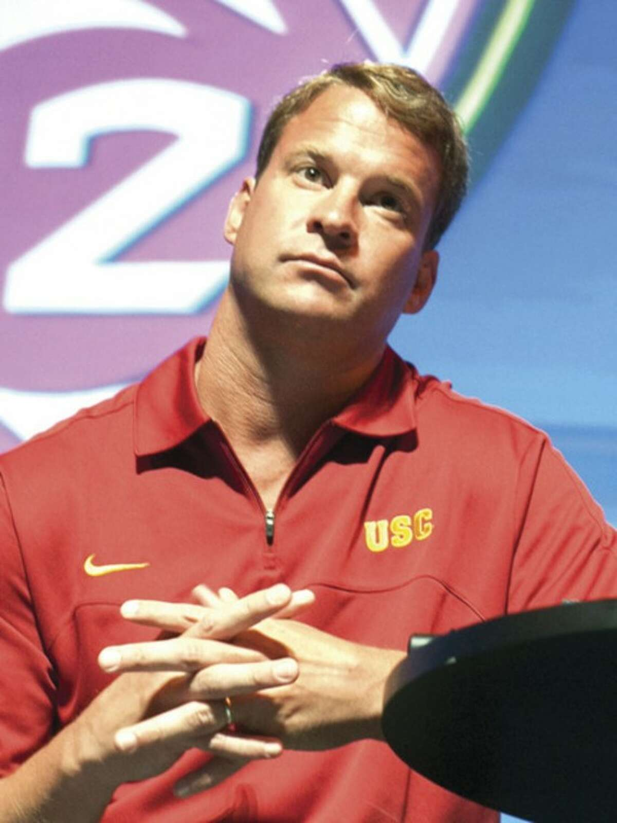 Southern California coach Lane Kiffin takes questions at the Pac-12 NCAA college football media day in Los Angeles, Tuesday, July 24, 2012. (AP Photo/Damian Dovarganes)