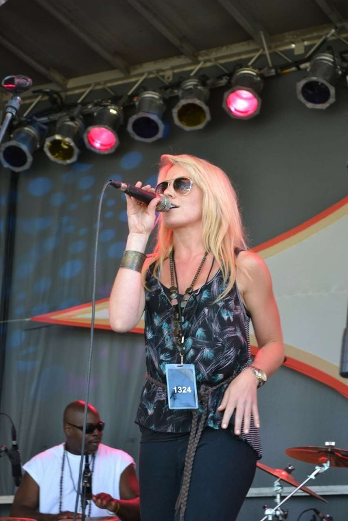 Country artist Nicole Frechette performs with Band Together CT at the 2012 Gathering of the Vibes. Photo: Mike Horyczun.