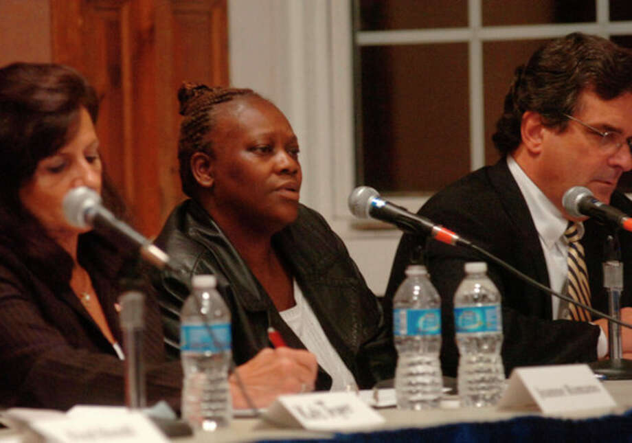 At large candidates for the Common Council including Sharon Stewart debate at the Norwalk City Hall Community Room Thursday night. Hour photo / Erik Trautmann / (C)2011, The Hour Newspapers, all rights reserved