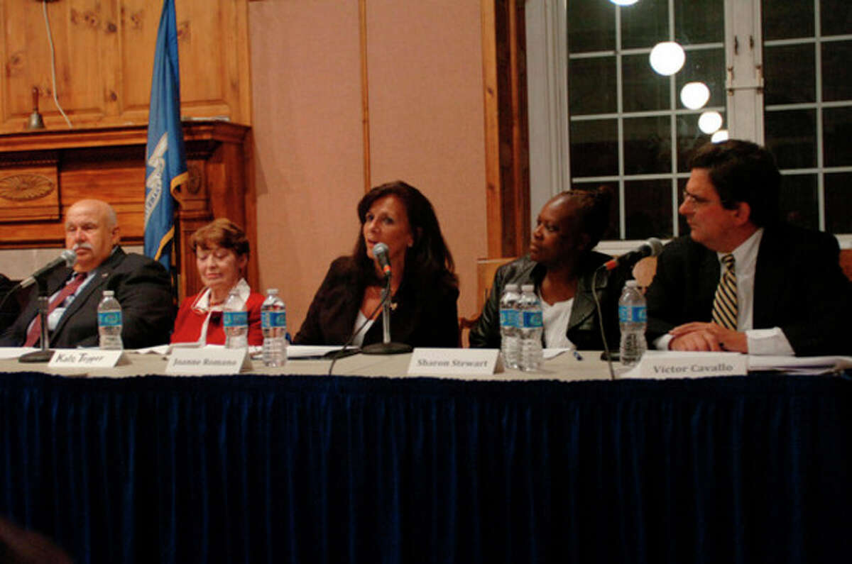 At large candidates for the Common Council including Joanne Romano debate at the Norwalk City Hall Community Room Thursday night. Hour photo / Erik Trautmann