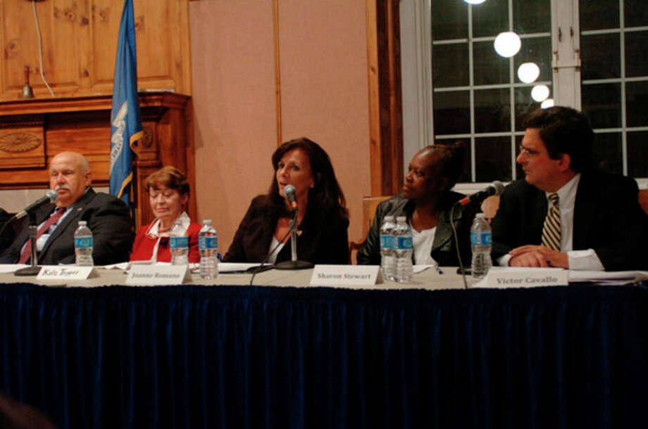 At large candidates for the Common Council including Joanne Romano debate at the Norwalk City Hall Community Room Thursday night. Hour photo / Erik Trautmann / (C)2011, The Hour Newspapers, all rights reserved