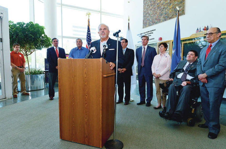 Former Lt. Governor Michael Fedele speaks at a press conference in support of Republican candidate for United States Congress, Steve Obsitnik, while Stamford Mayor Mike Pavia, Former Mayor Stan Esposito, State Senator Scott Frantz, State Representative Livvy Floren and State Representative Mike Molgano, look on at the Stamford Government Center Wednesday.Hour photo / Erik Trautmann / (C)2012, The Hour Newspapers, all rights reserved