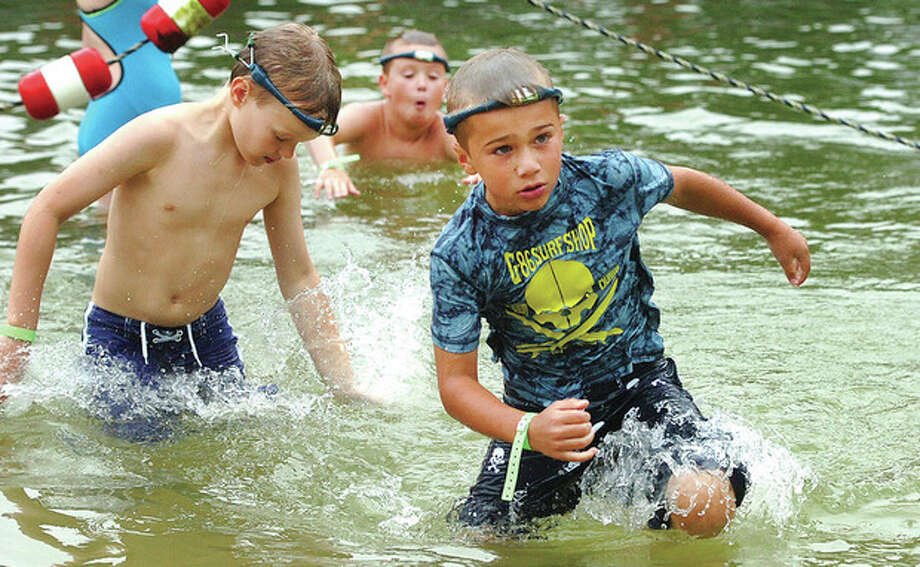 Hour Photo/ Alex von Kleydorff. Kids use the new Swimband at the Wilton family Y / 2012 The Hour Newspapers