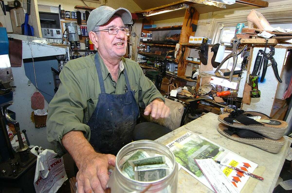 Hour Photo/ Alex von Kleydorff. Chris Kydes talks with a customer at The Wilton Shoemaker