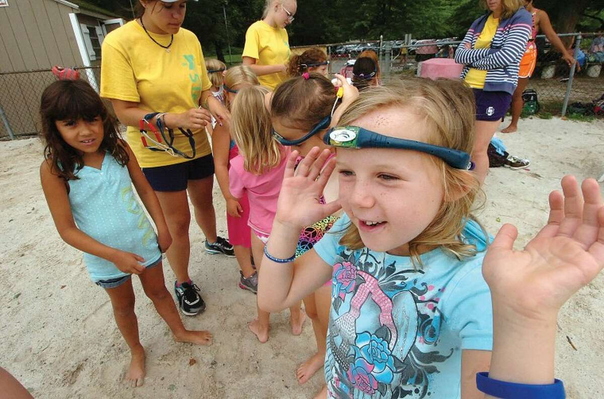 Hour Photo/ Alex von Kleydorff. 7yr old Mia Calabrese along with others are ready for a swim with the Wilton Y's new swimband in place.