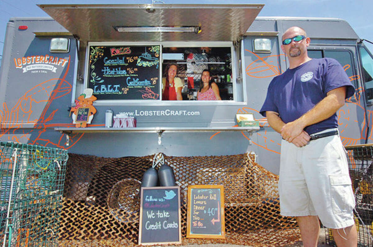 Michael Harden, right, and Laina Grillo and Liz Machette of LobsterCraft, which is open for lunch at Veteran's Memorial Park in Norwalk. Photo by Erik Trautmann