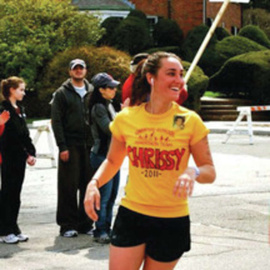 Contributed photoChristine Suchy of Wilton, running near Heartbreak Hill during the Boston Marathon, will compete in the San Francisco Marathon on July 29 to benefit the memory of two friends.