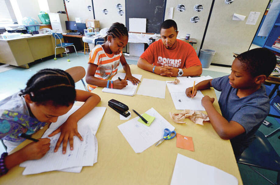 Fairfield County Community Foundation and Person-to-Person's summer day campers learn math at the Domus Foundation in Stamford. The camp hosts 58 elementary school students from low-income Stamford families with the sponsorship of Person-to-Person's Campership Program. The Campership Program helps provide a safe place for children whose parents work during the summer, meals/activities for the children, and academic opportunities to prevent summer learning loss.Hour photo / Erik Trautmann / (C)2012, The Hour Newspapers, all rights reserved