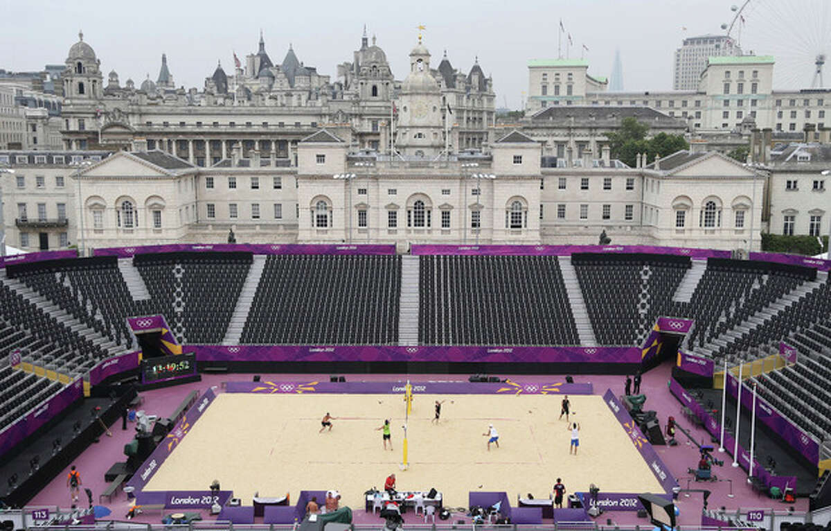 Players warm up during a Beach Volleyball practice session at the 2012 Summer Olympics, Friday, July 27, 2012, in London. (AP Photo/Petr David Josek)