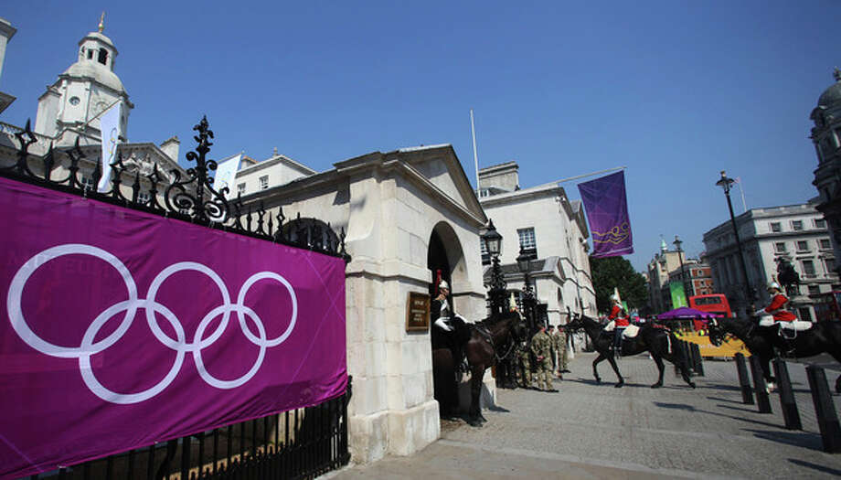 A members of the Horse Guards parade enter the Admiralty House at the 2012 Summer Olympics, Thursday, July 26, 2012, in London. Beach Volleyball competitions are held at the historic Horse Guards Parade downtown London. (AP Photo/Petr David Josek) / AP