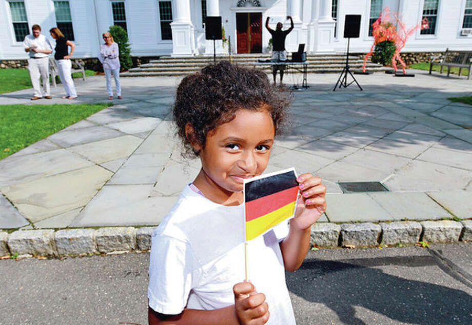 Hour photo / Erik TrautmannStudent Dayana Gonzales, 7, parades around the school grounds as the Horizons summer program at the New Canaan Country Day School holds their opening ceremonies of their Olympic Day Friday. / (C)2012, The Hour Newspapers, all rights reserved