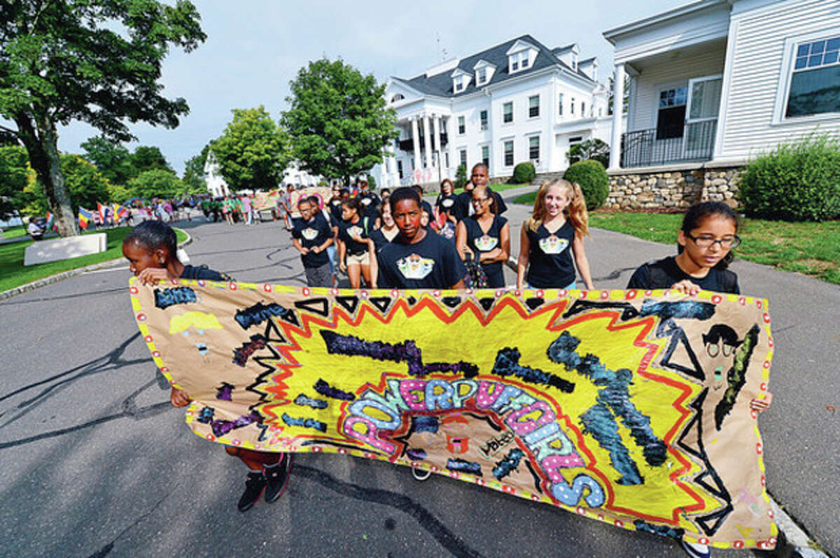 Hour photo / Erik Trautmann Staff and students parade around the school grounds as the Horizons summer program at New Canaan Country Day School holds its opening ceremonies of their Olympic Day Friday.