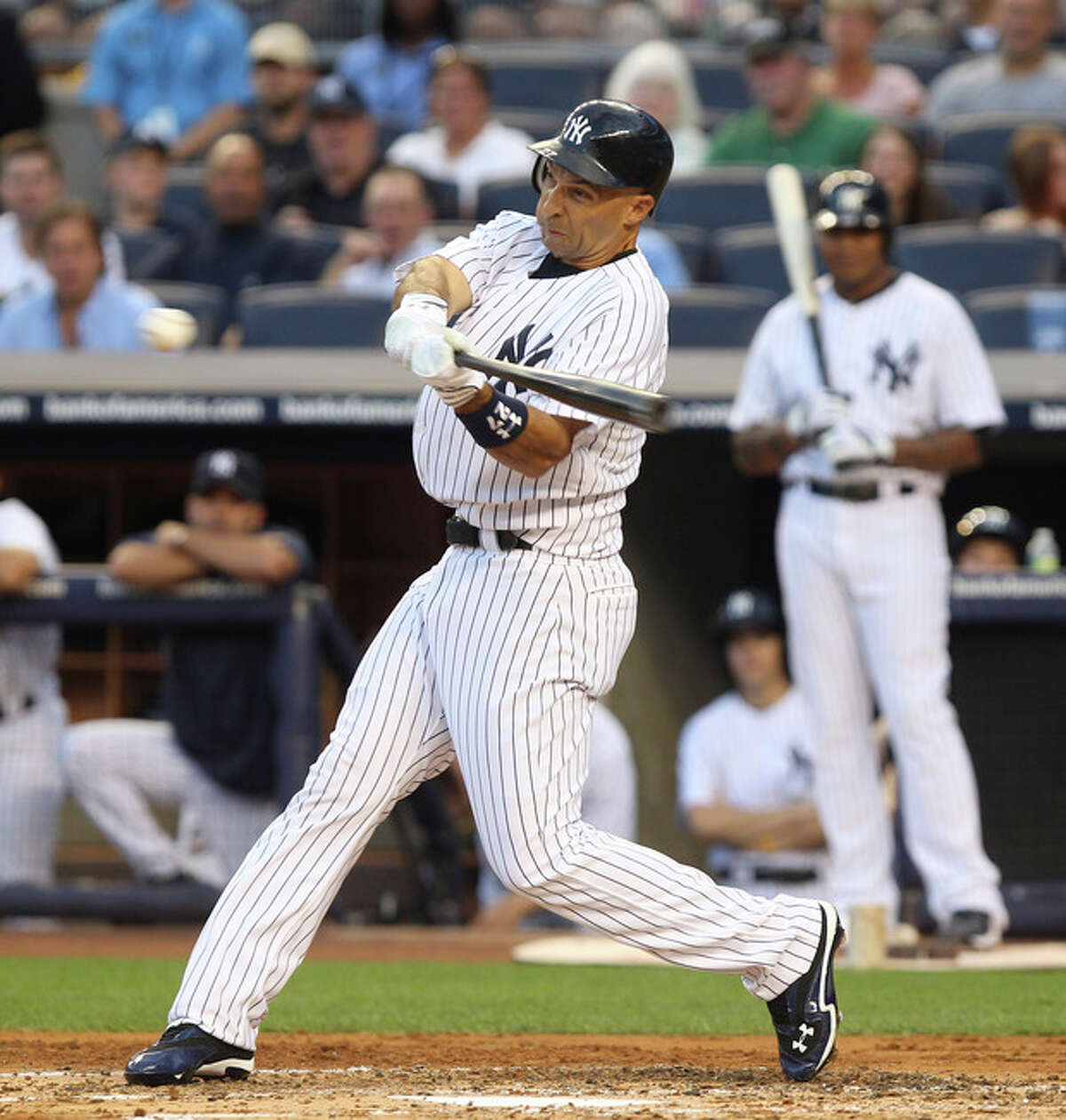 New York Yankees' Raul Ibanez hits a two-run home run during the first inning of the baseball game against the Boston Red Sox at Yankee Stadium in New York, Friday, July 27, 2012. (AP Photo/Seth Wenig)