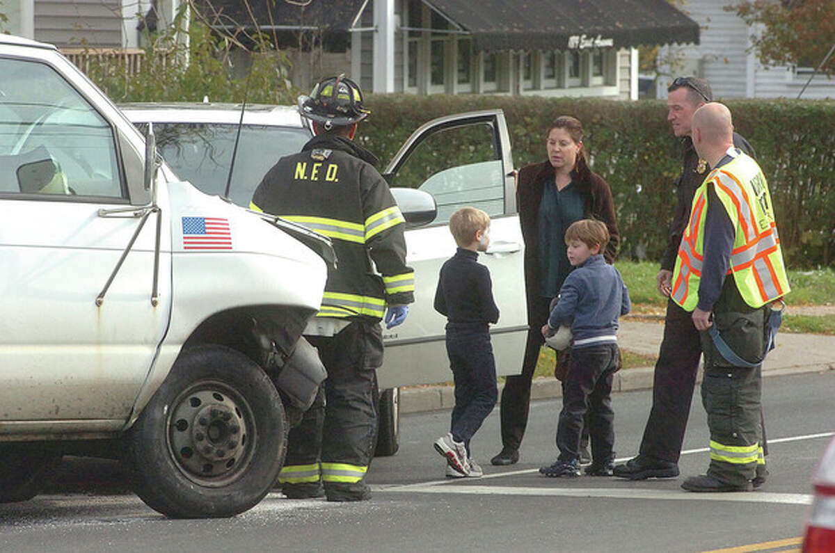Hour Photo/ Alex von Kleydorff. Occupants of an SUV that was hit by a box truck on East Ave make their way out of the vehicle on Monday at 2:45