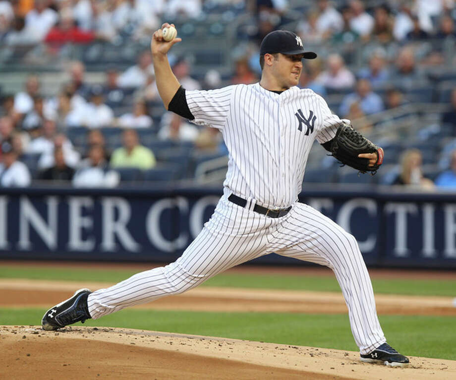 New York Yankees' Phil Hughes pitches during the first inning of the baseball game against the Boston Red Sox at Yankee Stadium in New York, Friday, July 27, 2012. (AP Photo/Seth Wenig) / AP