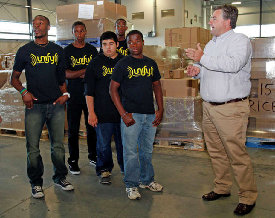 Rene Arnold, Chief Financial Officer of Wusthof Trident of America, Inc. teaches a little bit about his company and country to 5 students (Paul Stevens, Shynden Pierre, Leon Chavez, Willie Williams and Frantzer Michel) from the Norwalk YMCA who are about to leave for Germany.