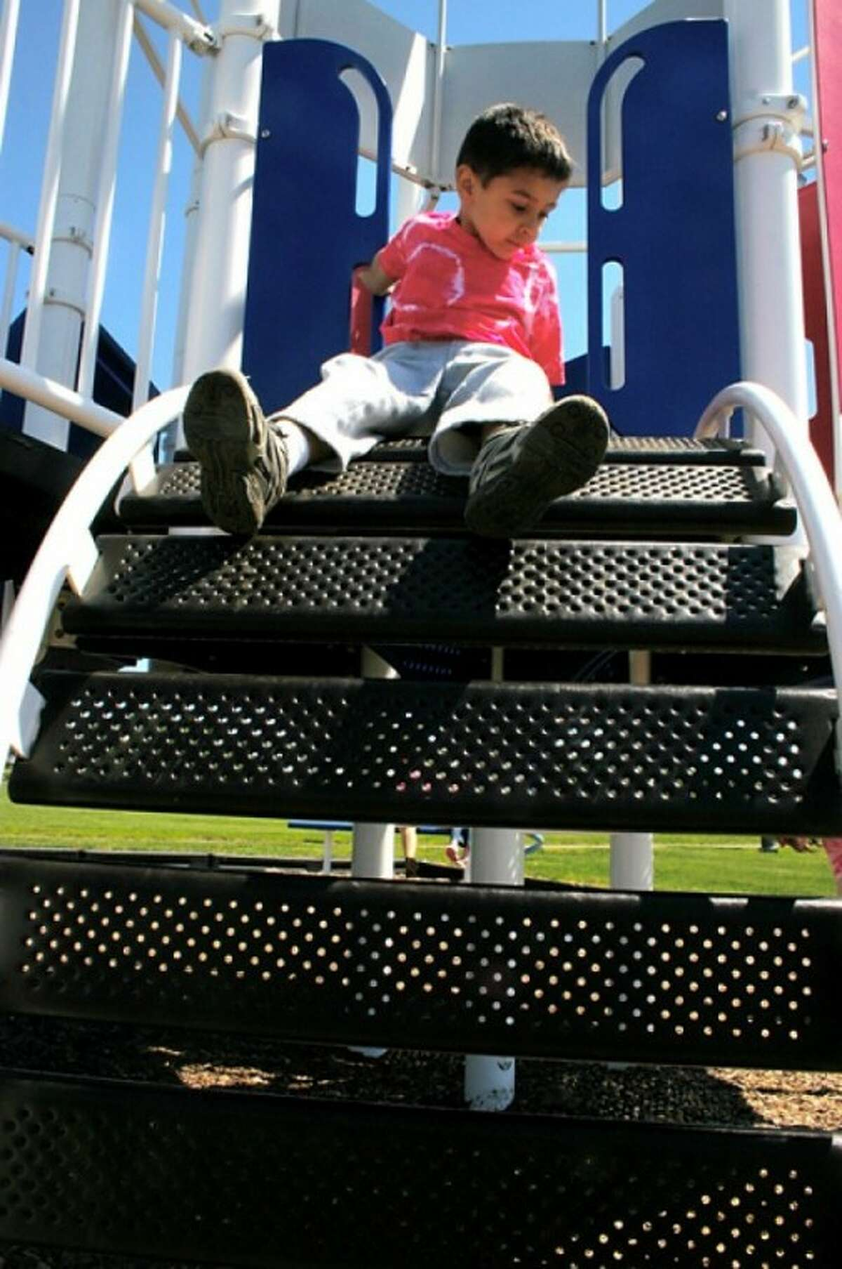 Cristen Curtas of Side by Side Charter school enjoys time on the play ground during a feild day in Norwalk Friday morning. Hour Photo / Lucina Sinclair
