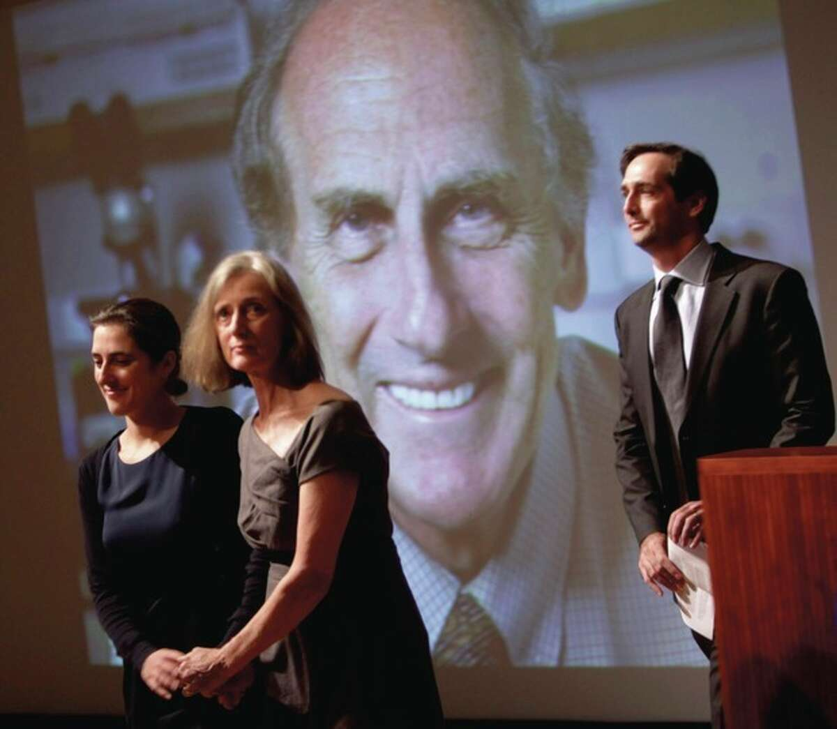 AP photo / Seth Wenig Family members of Nobel prize winner Ralph Steinman walk in front of a picture of Steinman during a ceremony honoring him at Rockefeller University in New York, Monday. From left to right are daughter Lesley Steinman, wife Claudia Steinman and son Adam Steinman.