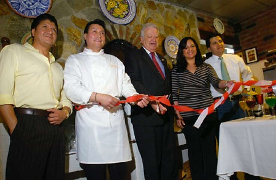 Co owner of Bella Pasta, Marcelo Rodriguez, Chef and co owner Jose Raul Rodriguez, Norwalk Mayor Richard Moccia, Vice President of the Ecuadorian Civic Comittee of Lower Fairfield County, Jennifer Wiesner, and co owner Fabian Rodriguez, cut the ribbon of the Rodriguez''s new restaurant during a brief ceremony Wednesday in SoNo. Hour photo / Erik Trautmann