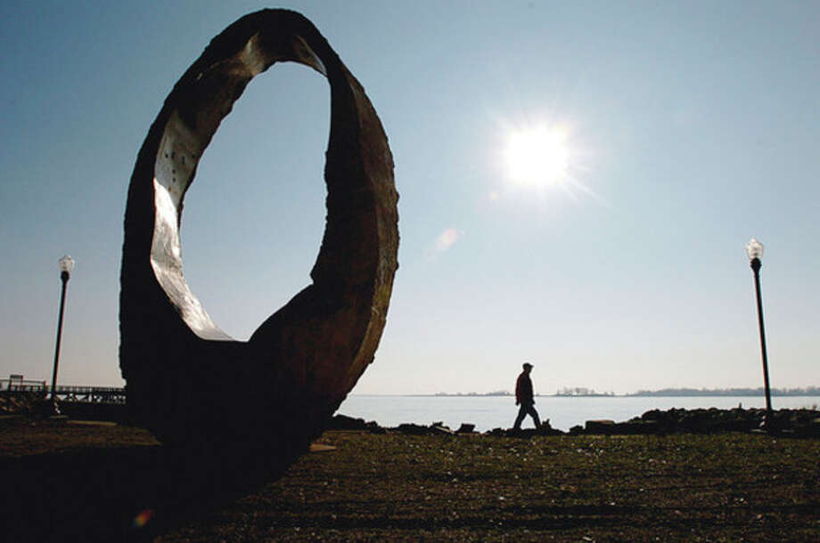 Hour photo / Erik Trautmann Sculptor, Peter Lundberg, assisted with the relocation of his work, a large multi-ton circular sculpture, from Oyster Shell Park to Calf Pasture Beach due to the ongoing renovations at Oyster Shell Park. / (C)2011, The Hour Newspapers, all rights reserved