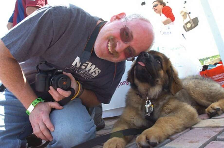 Scott Weiss with his 3 month old leonberger at the BooZoo''s Canine Carnival Sunday at Stepping Stones Museum. hour photo/matthew vinci