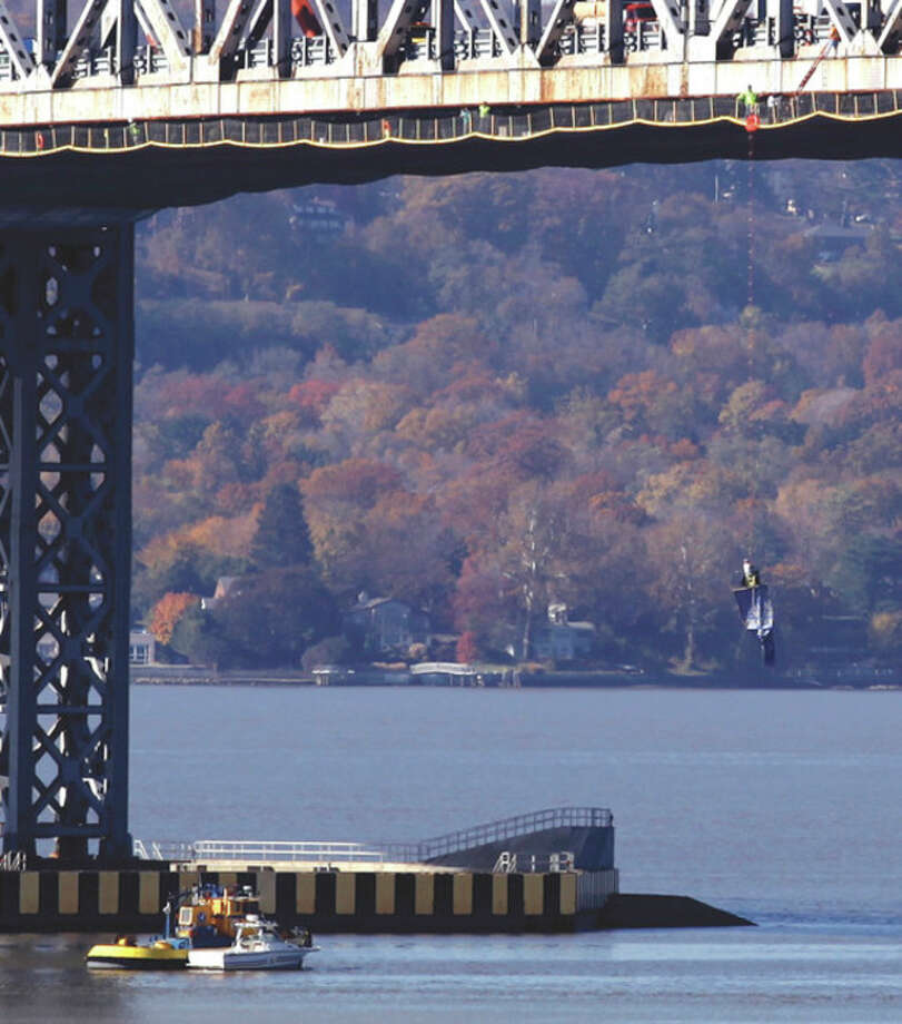 "AP photo / Craig Ruttle A man dangles from the Tappan Zee Bridge near Tarrytown, N.Y., Monday, holding a sign accusing Rockland County officials of a ""cover-up,"" according to The Journal News. / FR61802 AP"