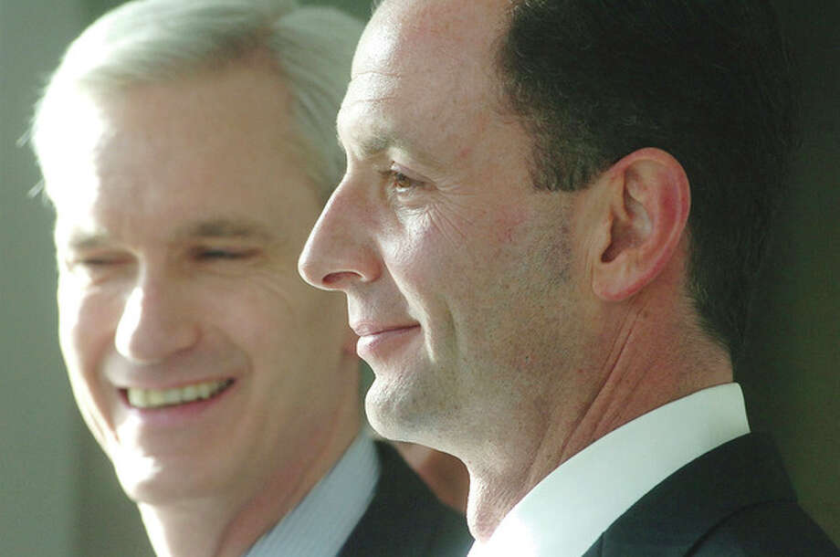 Photo/Alex von Kleydorff. Stamford Attorney Roy Occhiogrosso smiles with Sen Andrew MacDonald as Governor Elect Dan Malloy announces their appointment to his administration in Hartford. / © 2010 The Hour Newspapers/Alex von Kleydorff