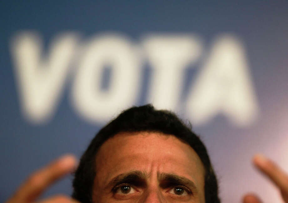 Opposition presidential candidate Henrique Capriles speaks during a news conference in Caracas, Venezuela, Saturday, April 13, 2013. Capriles is running against ruling party candidate and acting President Nicolas Maduro in Sunday's special presidential election. (AP Photo/Fernando Llano) / AP