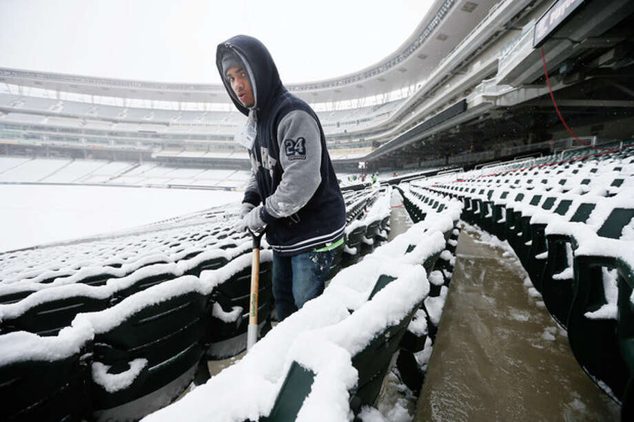 Kashaun Gage removes snow form Target Field on Thursday, April 11, 2013 in Minneapolis. A spring storm packing snow and ice has hit several states in the Midwest, knocking out power in communities and prompting Minnesota's governor to call out the state National Guard to help residents. (AP Photo/The Star Tribune, Jerry Holt) MANDATORY CREDIT; ST. PAUL PIONEER PRESS OUT; MAGS OUT; TWIN CITIES TV OUT / The Star Tribune
