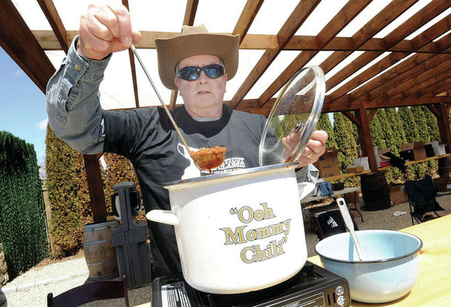Hour photo/Matthew VinciJimmy Leson shows off his Jimmy Crack Corn chili Sunday at the Connecticut Chili Classic held at the SONO Market.