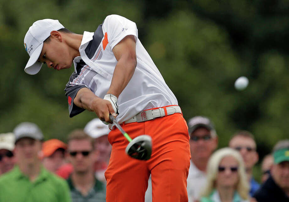 Amateur Guan Tianlang, of China, tees off on the 10th hole during the fourth round of the Masters golf tournament Sunday, April 14, 2013, in Augusta, Ga. (AP Photo/Charlie Riedel) / AP